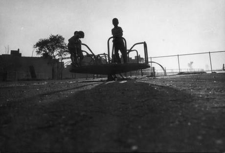 Children played at Columbia Point playground in 1968.